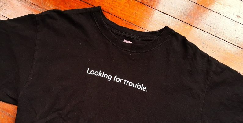 """T Shirt with """"looking for trouble"""" slogan"""